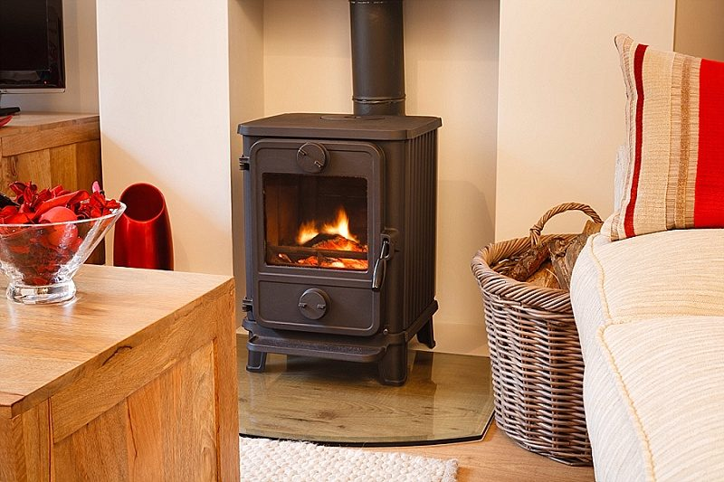 A wood burning stove with a lit fire